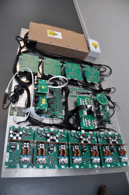 The entire electronics assembly for the BeoLab 90. The top portion in the brown MDF box is the power supply. Moving down the photo, the 4 PCB's are the woofer amplifiers. Next are the input and DSP boards. (Note the 18 DAC's in a row on the DSP board.) On the bottom are the 14 ICEpower amplifiers.