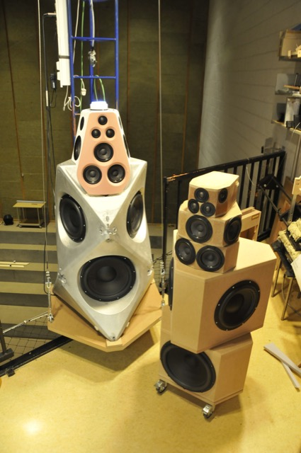 "Prototype 4 (on the floor) was basically the same as Prototype 3, but with a different woofer arrangement. Instead of 4 matched 13"" drivers, this version used three 10"" drivers and one 13"" in the front. On the crane is the first sample with the original mechanical design."