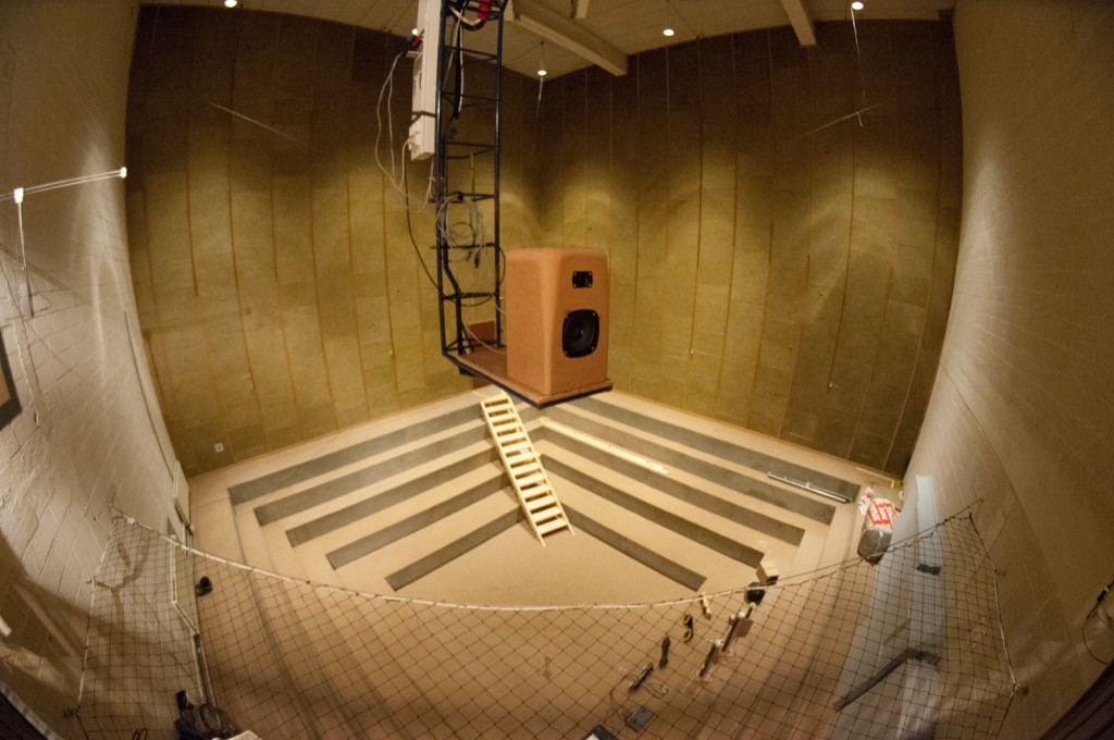 Figure X: A prototype loudspeaker made of MDF on the crane, on its way out to be measured.